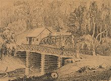drawing of a wooden building with a water wheel behind a log bridge