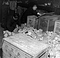 Carrying Cash in Republican China - Local bank employees removing paper money from wooden boxes.jpg