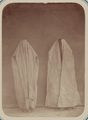Central Asian Women's Adornment and Clothing. Two Women Wearing Burqas WDL11192.png