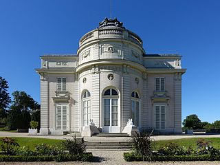 small neoclassical château with a rose garden and orangerie in the Bois de Boulogne, Paris