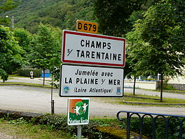 Road signs entering Champs-sur-Tarentaine-Marchal, on the D679 road