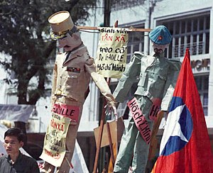 "1954 Geneva Conference - ""Charles de Gaulle and Ho Chi Minh are hanged"" in effigy by students demonstrating in Saigon, July 1964, on the 10th anniversary of the Geneva Accords."