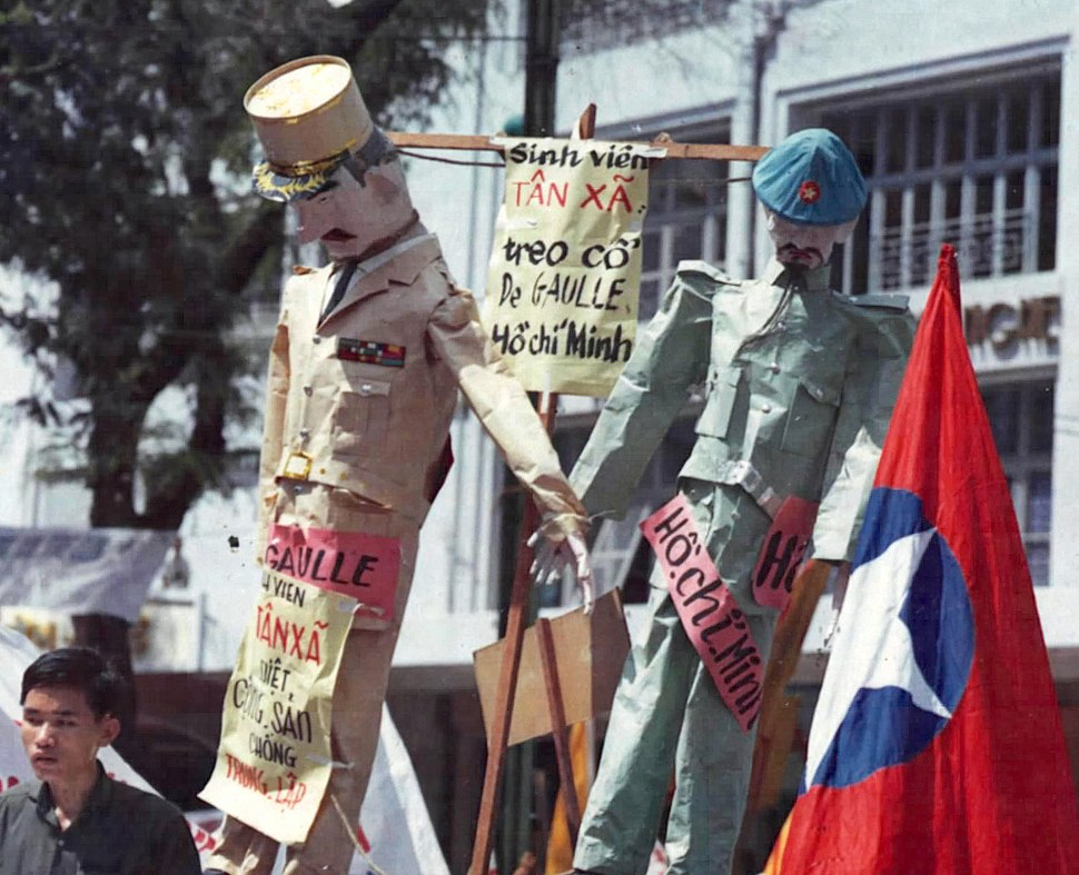 Charles DeGaulle and Ho Chi Minh are hanged in effigy during the National Shame Day celebration in Saigon, July 1964