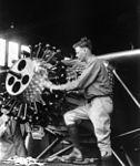 Charles Lindbergh working on engine cph.3a51858.jpg