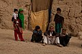 Children gather in a street patrolled by U.S. and Afghan soldiers, in the Maiwand district, Kandahar province, Afghanistan, Feb. 24, 2012 120224-A-QD683-223.jpg