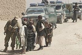 Children greet Soldiers in Tarin Kowt.jpg