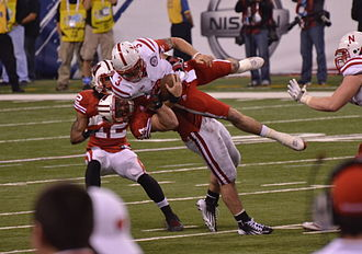 Wisconsin Badgers football - Wisconsin linebacker Chris Borland tackles Nebraska quarterback Taylor Martinez during the 2012 Big Ten Football Championship Game