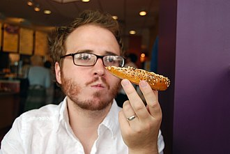 Stuff White People Like - Author Christian Lander eating an everything bagel in Mar Vista, Los Angeles, California in 2008.