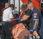 Coast Guard rescues man, dog after sailboat catches fire 69 miles west of Hudson, Fla. 150710-G-RD053-011.jpg
