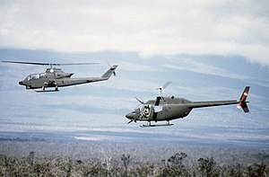 19th Cavalry Regiment (United States) - An AH-1 Cobra helicopter (front) and an OH-58 Kiowa of the troop flying in formation during Exercise Opportune Journey, 1985