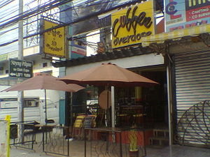 Front of coffee shop taken by mobile phone.