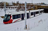 Confederation Line train testing near St. Laurent station, January 2018.jpg