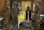 Custom-made bed helps Afghan family cope 110720-F-RN211-032.jpg