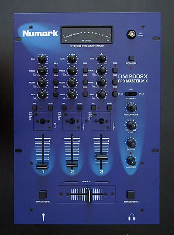 A Numark DM2002X Pro Master DJ mixer. This three channel mixer can have up to three input sound sources. The gain control knobs and equalization control knobs allow the volume and tone of each sound source to be adjusted. The vertical faders allow for further adjustment of the volume of each sound source. The horizontally-mounted crossfader enables the DJ to smoothly transition from a song on one sound source to a song from a different sound source. DJ Mixer.JPG