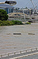 Debris floating down the flooded Brisbane River 3.jpg