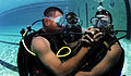 Defense.gov News Photo 100817-N-9769P-178 - Panamanian diver Cpl. Edwin Sanchez left shares his regulator with Cpl. Jamie Berchi right in Panama City Panama on Aug. 17 2010. U.S. Navy.jpg