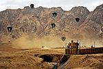 Defense.gov News Photo 111126-F-FT240-046 - Aircrews drop supplies over the village of Shah Joy Afghanistan on Nov. 26 2011. The supplies sustain forward operating bases combat outposts.jpg