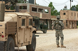 Combat Identification Panel - The CIP is the large square panel mounted directly above the rear axle of the nearest Humvee