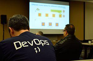 DevOps - DevOps T-shirt worn at a computer conference.