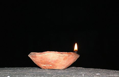 Traditional Indian earthenware oil lamp or diya