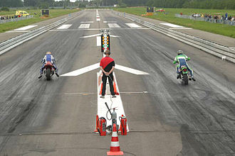 Motorcycle testing and measurement - Two motorcycles at a ¼ mile (402 m) dragstrip.
