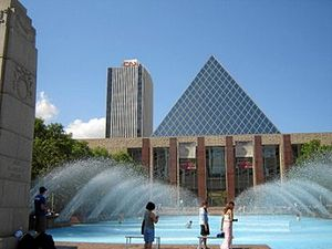 Edmonton City Hall - City Hall's main pyramid and fountain. To the left is a cenotaph; in the background is the CN Tower.