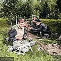 Estonian forest brothers relaxing and cleaning their guns after a shooting exercise in Veskiaru, Järva County, Estonia, 1953. (47953893422).jpg