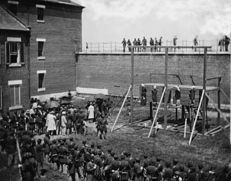 Fort Lesley J. McNair - Execution of Mary Surratt, Lewis Powell, David Herold, and George Atzerodt on July 7, 1865 in the courtyard of Washington Arsenal (now Fort McNair). Photo by Alexander Gardner.