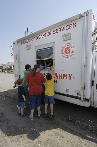 Mobile catering - People in Caruthersville, Missouri receiving food and supplies from a Salvation Army disaster relief truck in April 2006