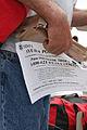 FEMA - 38107 - A man holds a FEMA flier and MRE in Louisiana.jpg