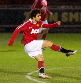 Fábio taking a shot for Manchester United reserves vs Rochdale