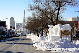 Festival du Voyageur - Snow sculpture on Provencher Ave, with the Esplanade Riel in the background