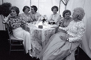 Former First Ladies Nancy Reagan, Lady Bird Johnson, Hillary Rodham Clinton, Rosalynn Carter, Betty Ford and Barbara Bush sit together at the National Garden Gala, A Tribute to America's First Ladies, May 11, 1994. Jacqueline Kennedy Onassis was unable to attend due to illness, and died a week after this photograph was taken.