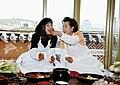 First lady Kim Yoon-ok, right, serves kimchi to Miyuki Hatoyama, wife of Japan's Prime Minister Yukio Hatoyama, while making kimchi together (4347816896).jpg