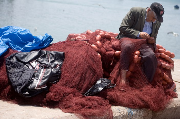 Fisherman mending net