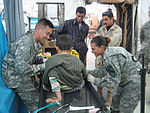 Flight Surgeon in Iraq Treats Injured Local Child DVIDS35051.jpg
