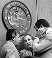 Florida House Representatives conferring under the state seal.jpg