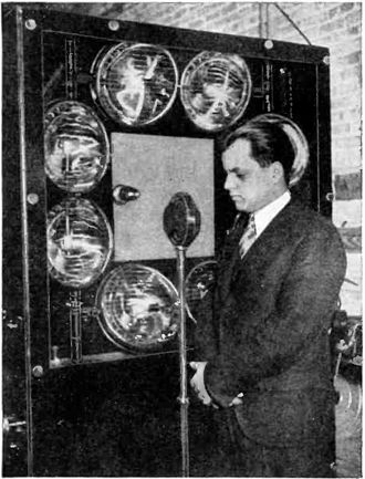 Ulises Armand Sanabria - Sanabria in front of a flying spot scanner he developed