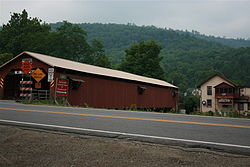 Forksville Covered Bridge, built 1850, over Loyalsock Creek with the Forksville General Store behind