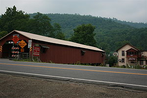 Forksville, Pennsylvania - Forksville Covered Bridge, built 1850, over Loyalsock Creek with the Forksville General Store behind
