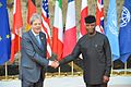 G7 Taormina Paolo Gentiloni Yemi Osinbajo handshake 2017-05-27.jpg
