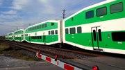 File:GO Train at level crossing.webm