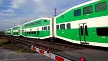 File:GO Train at level crossing.webm