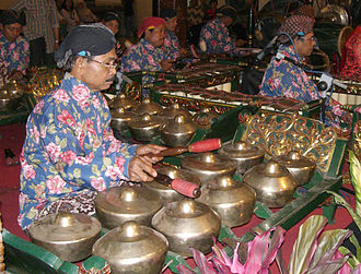 Gamelan - A gamelan player playing bonang. Gamelan Yogyakarta style during a Javanese wedding.