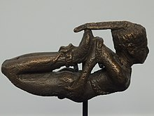 Bronze figurine of a bound man.