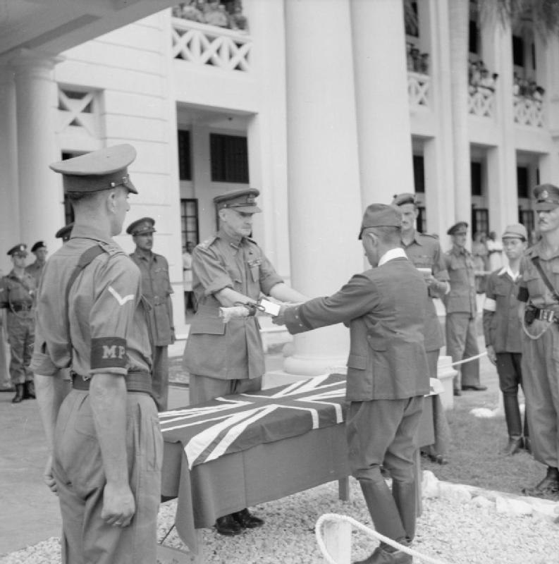 The surrender ceremony of the Japanese to the British forces with General Itagaki surrendering his sword to General Frank Messervy at Kuala Lumpur, British Malaya on February 22, 1946