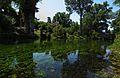 Giardino di Ninfa - ruderi di mulino lungo il fiume Ninfa.jpg