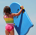 Girl with a colorful swimming board.jpg