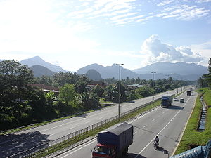 Gopeng - An ordinary morning scene on a clear day of Gopeng Road overlooking Kampung Tersusun Kampung Pulai and the mountains.