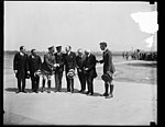 Group at field; Frank Kellogg second from right; U.S. Capitol visible in distance LCCN2016888772.jpg